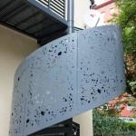 Spindeltreppe mit Geländerfüllung aus gelaserten Blechen